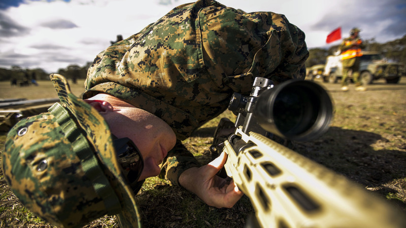 Sergeant Tanner Grace, a native of Troy, Pennsylvania, and an armorer for the Marine Corps Shooting Team, works on the next-generation M40 sniper rifle during sniper rifle snap-in match May 10 at the Puckapunyal Military Area, Victoria, Australia, during the Australian Army Skill at Arms Meeting 2015. Grace was only international armorer supporting AASAM, an annual, international combat-marksmanship competition hosted by the Australian Army, May 6 to 22. During the competition, he worked on number of other nation's service pistols, rifles, sniper rifles and machine guns. AASAM competition afforded an unprecedented combined training opportunity and improved interoperability with Australian Defense Forces and other militaries present at AASAM 2015. (U.S. Marine Corps photo by Sgt. Marcin Platek/Released)