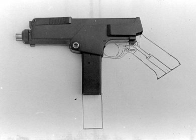 What was left of the first MPA on top of a 1:1 scale drawing of the pistol. The long 40-round magazine sketched was apparently used for photographic purposes, only.