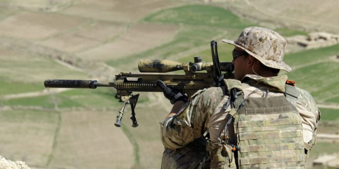 A_coalition_Special_Operations_Forces_member_fires_his_sniper_rifle_from_a_hilltop_during_a_firefight_near_Nawa_Garay_village_(120403-N-MY805-202)