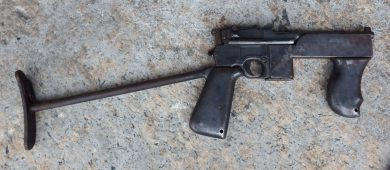 "The ""Mod. 2"" batch involved 89 pistols. This particular example (""Policia Militar D.F. No. 605"", Serial 81398) sports the same fore grip of ""Mod.1"" gun plus an all-metal, re-shaped main grip."