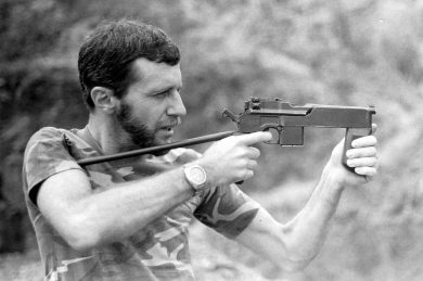 """Preparing to fire the """"Modification 2"""" from the shoulder, hammer cocked. Now, 33 years later, I can't remember why my left thumb was not fully holding the vertical support grip…"""