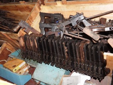 """Regrettably, a whole bunch of PASAMs are now rusting in a Rio de Janeiro Military Police warehouse. Twenty-three """"Mod.1"""" guns can be seen lined up in the foreground, with a pile of """"Mod.2"""" variants behind."""
