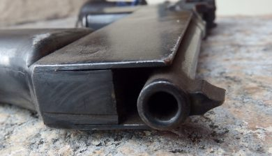 """This close-up view of a """"Mod.2"""" pistol shows how the frame extension leaves the barrel free to travel rearwards (short recoil) during fire."""