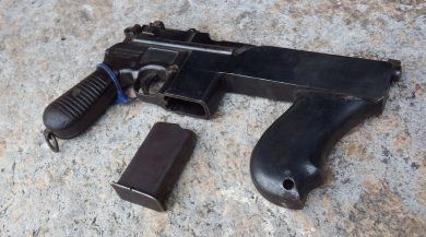 """With no stock fitted and the 10-round magazine outside its housing, this """"Mod.2"""" displays the sturdy metal forward grip."""
