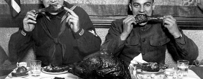 The best Thanksgiving ever? A US soldier and sailor both enjoy some turkey 17 days after the Armistice that ended the War to End All Wars.