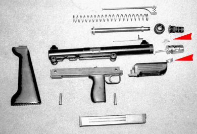 A BSM9/M1 field stripped. The two wedges that projected sideways from the cylindrical bolt to delay the blowback action are shown by the arrows.