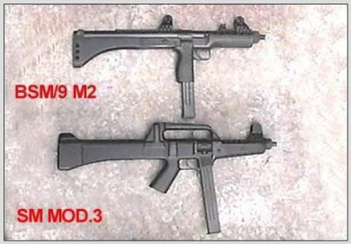 """Although externally different from the earlier Bérgom BSM/9 M2 """"Skeleton"""", the LAPA SM MOD.3 did incorporate common features such as the straight-line (barrel/butt plate) configuration, the raised sights, and the use of polymer components."""