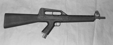 The CA MOD.02 prototype was distinguishable from the semi-auto model by the larger capacity magazine in the pistol grip and the curved shape of the cocking lever within the carry handle.