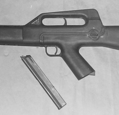 "Closer view of the selective-fire CA MOD.02 shows the disc-shaped fire selector with the markings ""S"" (front), ""1"" (top), and ""30"" (rear) displayed in a 180 degrees arc."