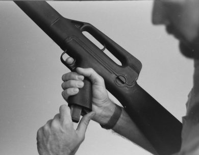 The magazine catch was located at the rear bottom of the pistol grip, being pressed forward to actuate.