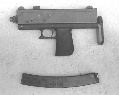 "The MSM is seen here with the pistol-type grip, stock retracted, and 32-round magazine removed. Note the three-position (""S"", ""1"", ""30"") fire selector lever on the left side."