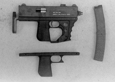 The two types of polymer grips were easily interchangeable to answer the shooter's preference. Three perpendicular pins held the part attached to the gun's body.