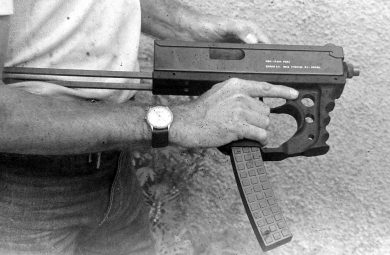 The double-grip unit of the MSM gave it a characteristic look, as did the waffle-style polymer magazine. The gun is seen here being cocked.