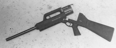 The weapon in the broken barrel position to allow ammo loading into the prominent 5-round cylinder.