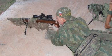Author giving the Imbel rifle a chance to consistently demonstrate its basic 1 MOA-ability at 100 meters: it did.