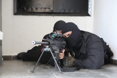 A Brazilian Marine of the Tonelero Battalion takes aim with the PGM Ultima Ratio rifle. A Zeiss Optronics NSV600 night vision device can be attached directly ahead of the scope.
