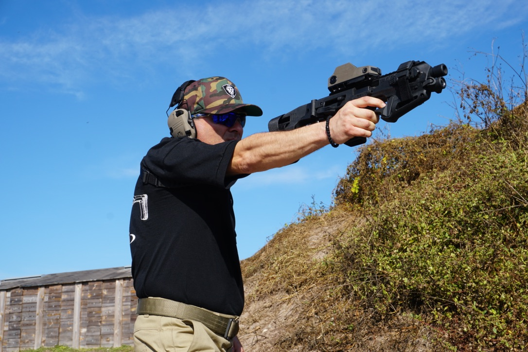 It makes one handed pistol (er, micro RONI with stabilizer) shooting easier. Anyone up for making a slide cut out? :)