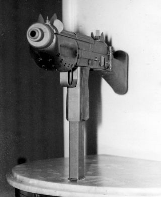 The business end of the BSM9/M1. Ventilation orifices in the handguard and the blade-type cocking piece( at about 45 degrees to the left side) are shown.