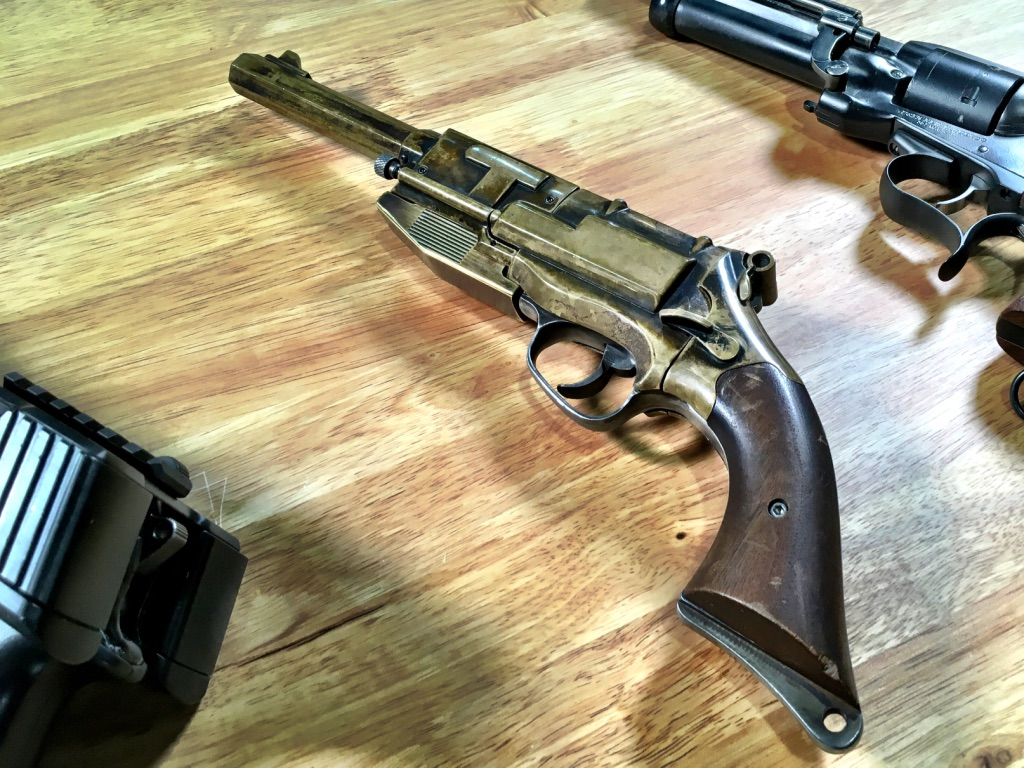 Mal's Sidearm, the Moses Brothers Self-Defense Engine Frontier Model B, is actually a modified Taurus 85 completely covered by brass castings.
