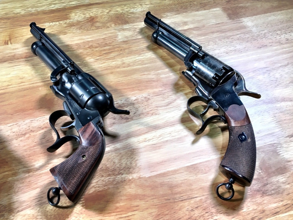 """The Man in Black's LeMat 1861 used for close ups. Next to it is a custom built """"replica"""" that was more comfortable to shoot and operate."""