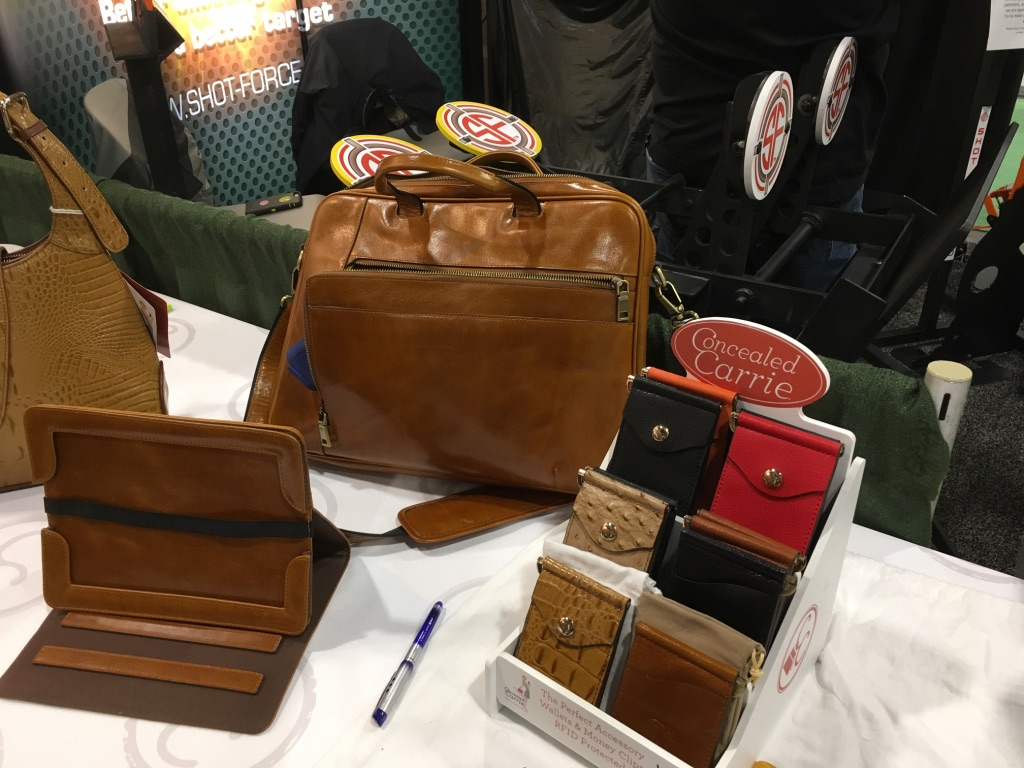Man's briefcase--I don't see why it should not work for a woman though... On the left is the removable tablet cover and stand.