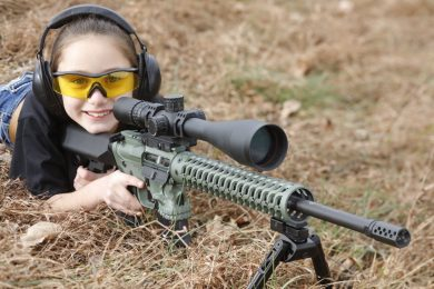 young girl with semi-auto rifle