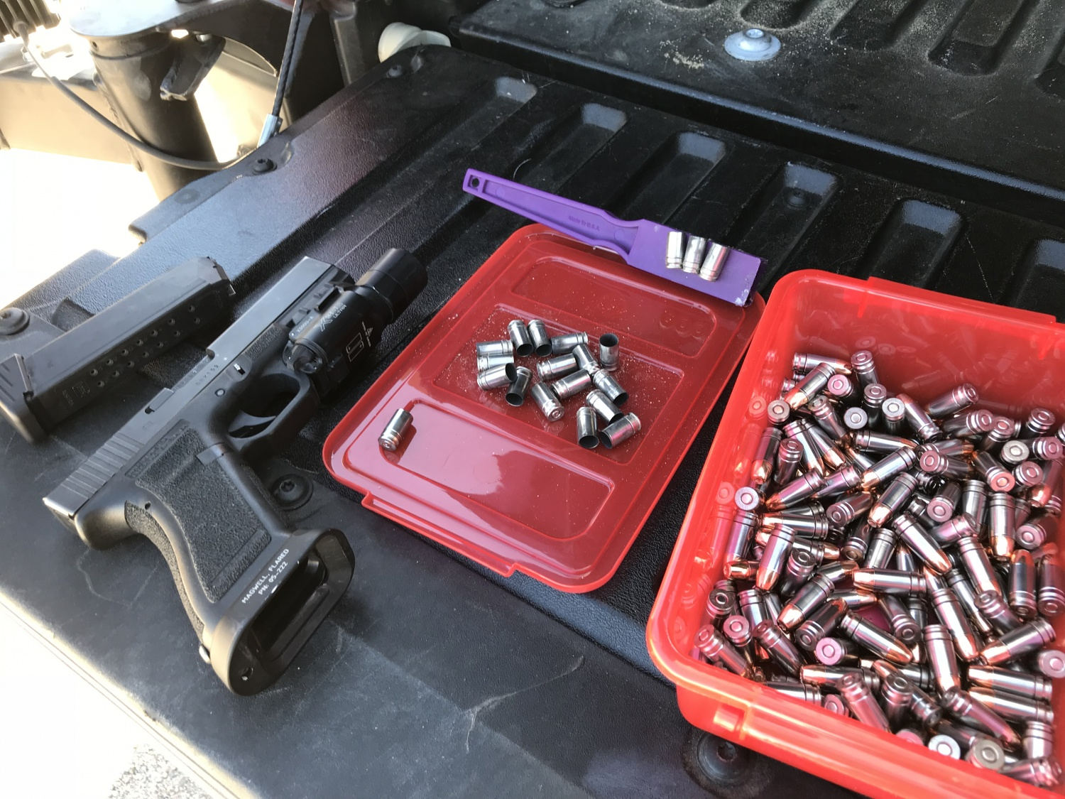 Spent NAS3 casings next to freshly loaded rounds. Note the purple magnet; these are very easy to pick up at the range.