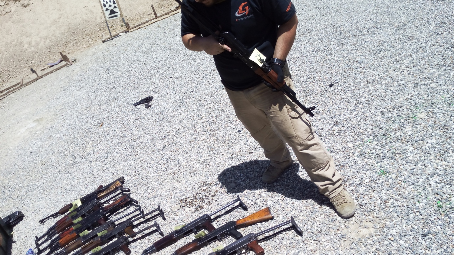 The author at the shooting range near Kabul doing some AK test fire.