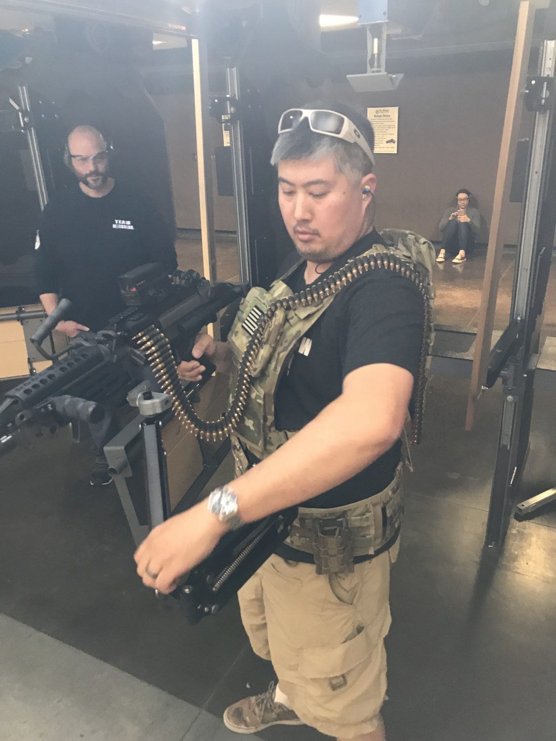 Nick C setting up a M249S on his steadicam third arm with a 200 rd belt drapped over his shoulder