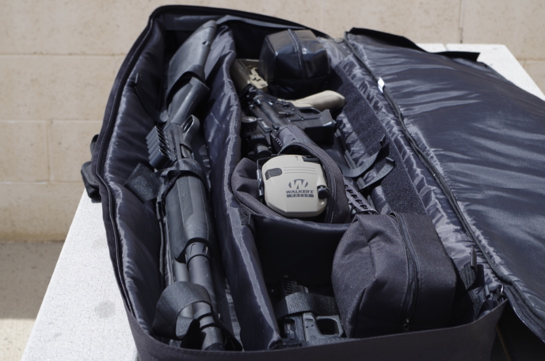 The 3GUN Softcase just swallows up guns. And it had like 400 feet of velcro strapping to anchor your long guns. If I had been a smarter monkey I would have stored the electronics in the waterproof pouch (at the rear)--but it's not like Phoenix ever gets rain.