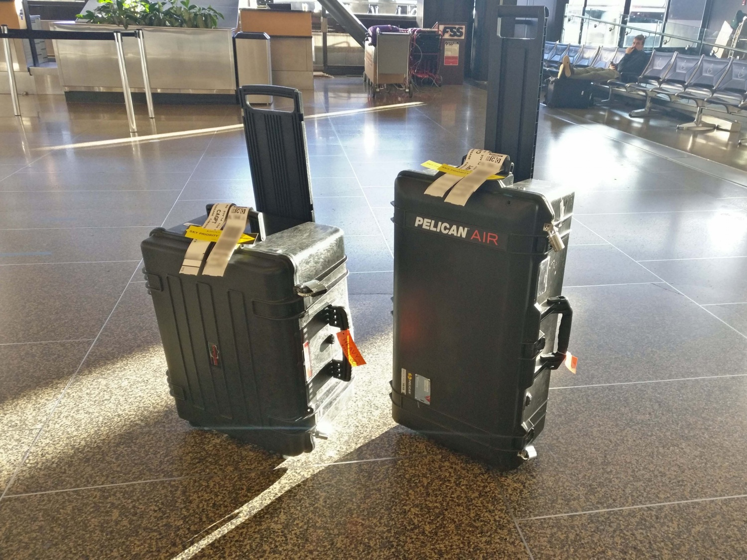 The author's new Explorer Case (left) next to his one remaining Pelican Air case (right) as he prepares to surrender them to the TSA and his air carrier's luggage throwers.