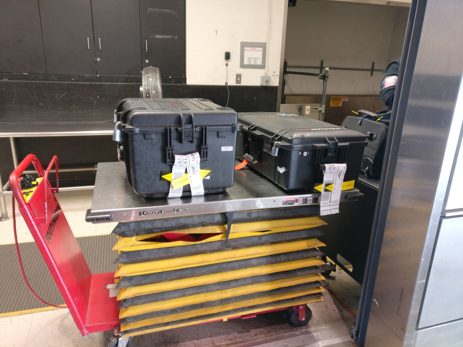 Explorer Case 5833 on the TSA's inspection table next to the author's old Pelican Air 1615… both of which sport Abloy Protec padlocks