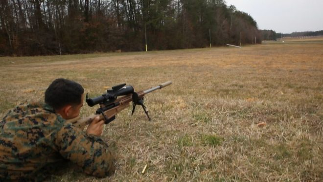 Sgt. Randy Robles, Quantico Scout Sniper School instructor and Marine Corps Systems Command liaison, demonstrates the Mk13 Mod 7 Sniper Rifle during training aboard Marine Corps Base Quantico, Virginia. MCSC will field the Mk13 in late 2018 and throughout 2019 to increase the lethality and combat effectiveness of scout snipers on the battlefield. (U.S. Marine Corps photo by Kristen Murphy)