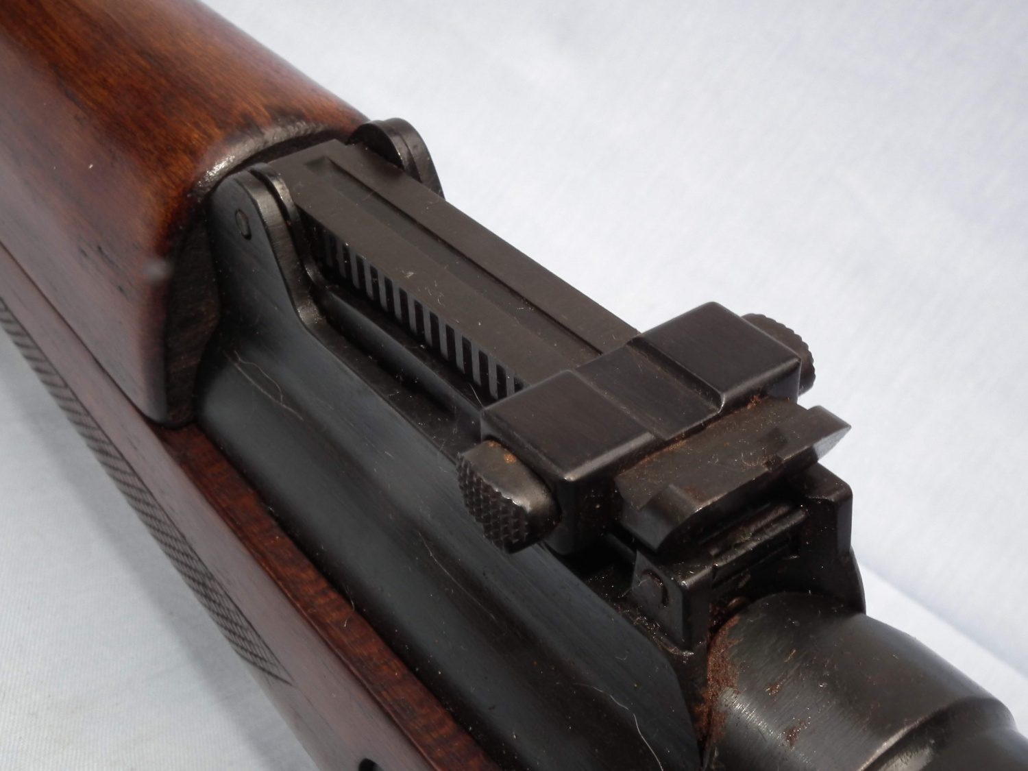 The same gun's adjustable ramp notch rear sight. It can be noticed that no range adjustment markings are present.
