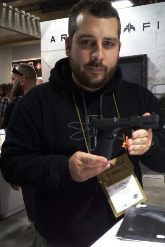Author and STRYK B (Type B) pistol at the Shot Show 2018