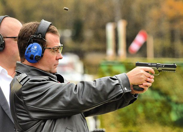 Former Russian president and current Prime Minister Dmitri Medvedev shooting Strike One pistol, October 3, 2012. Picture courtesy of Arsenal Firearms.