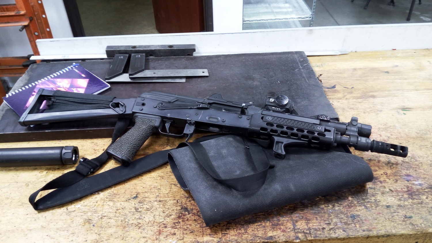 One of Travis Haley personal AKs, built by Rifle Dynamics.Aimpoint red dot sight is mounted on the Ultimak rail.