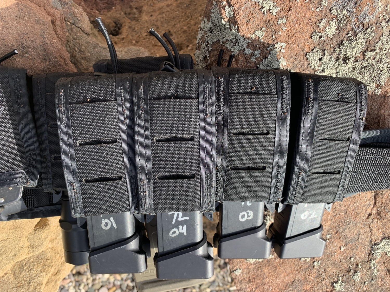 The Duty line from High Speed Gear has a much cleaner look without sacrificing any of the functionality. You can still attach additional pouches to the outside and adjust the internal tension.
