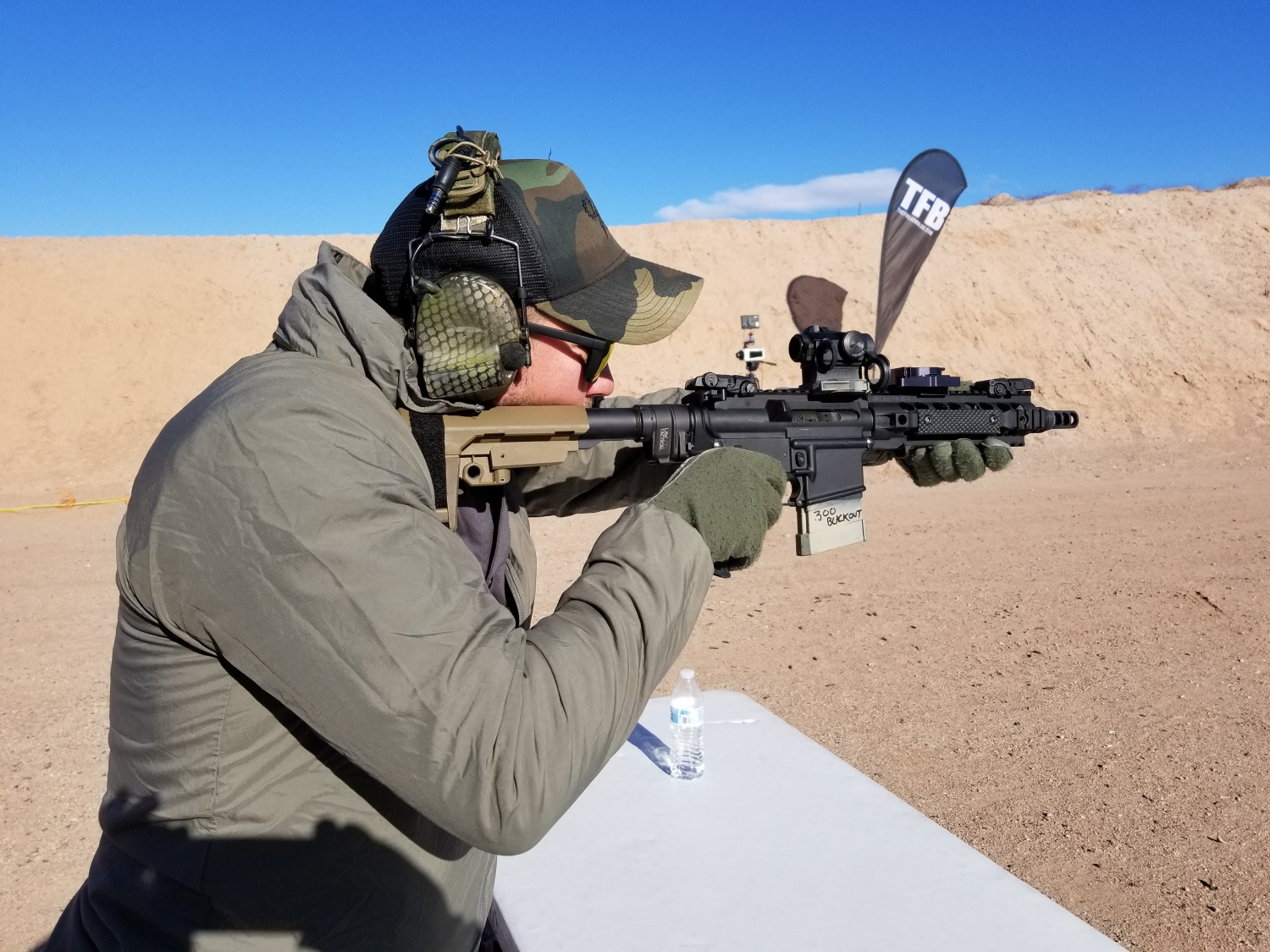 Representative of Axeon optics with 300 BLK pistol.