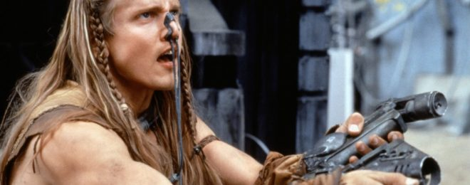 Scene from Battlefield Earth. Hero with pistol with barrel below hand.