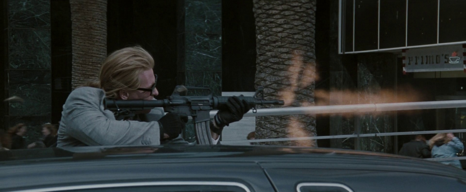 Kilmer, as Shiherlis, fires his 733 in Heat's classic shootout scene