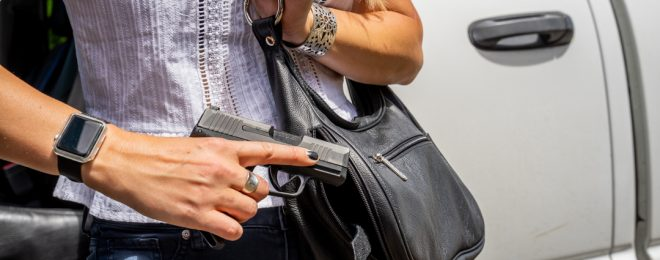 "Galco offers purses with specialized pistol pockets, like this ""Dyna"" model."