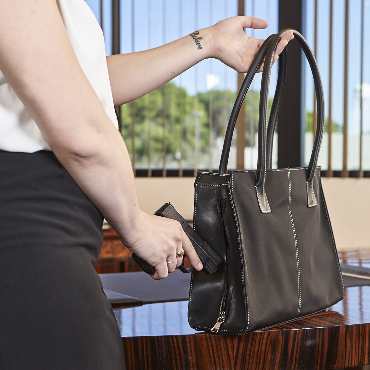 "Another handbag option that's a little higher-end, this ""Metropolitan"" model carries a $300 MSRP versus $190 for the ""Dyna"" shown above."