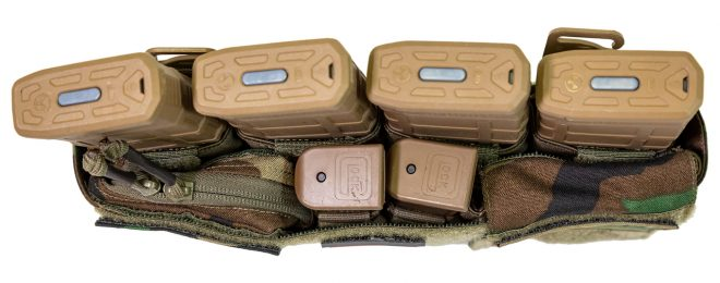 Tactical nylon company Defense Mechanisms has added to their product offerings, including the zippered half pocket for their modular placard system shown here.