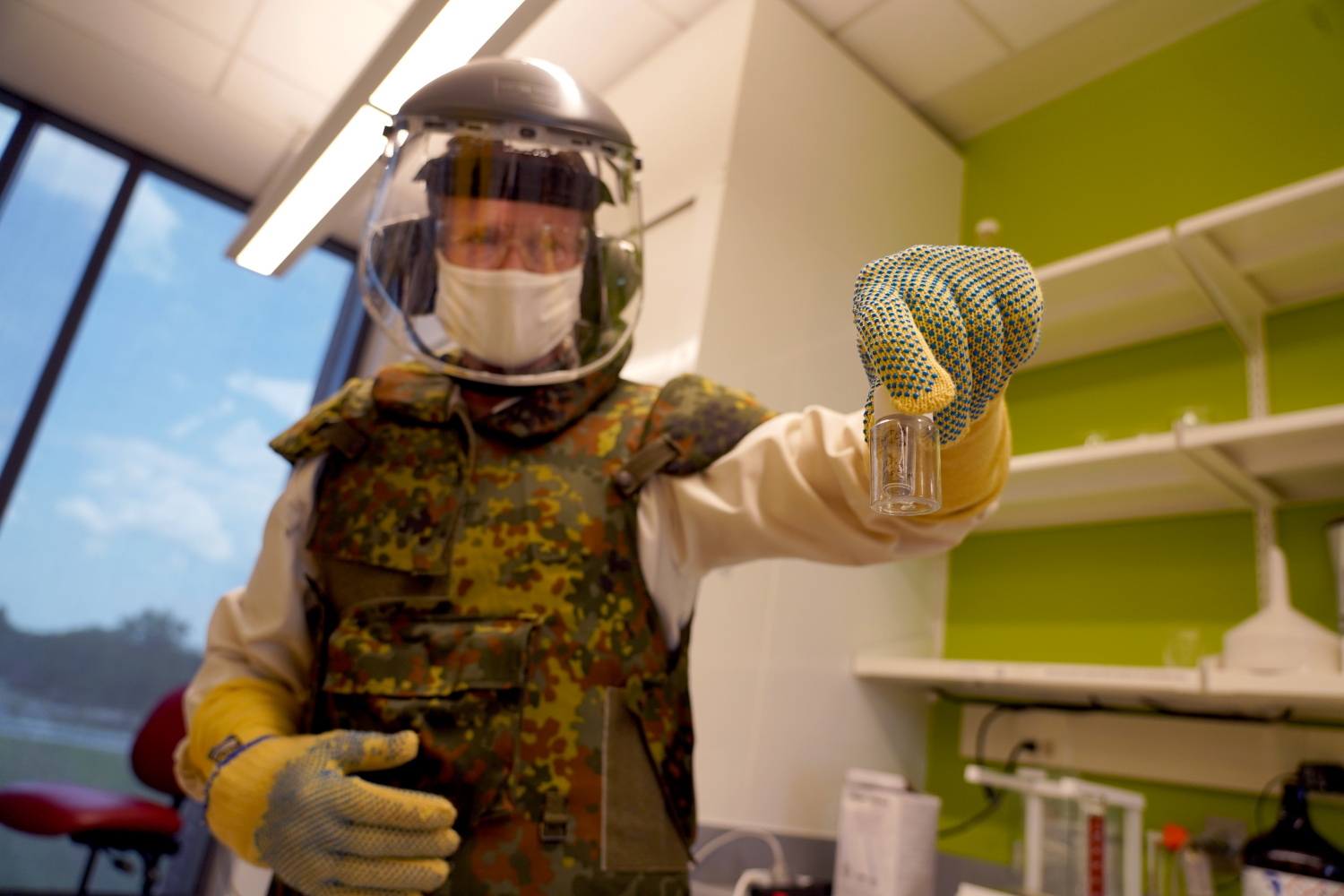 Purdue scientist and Ph.D. candidate Matthew Gettings works on the Army project in protective gear.