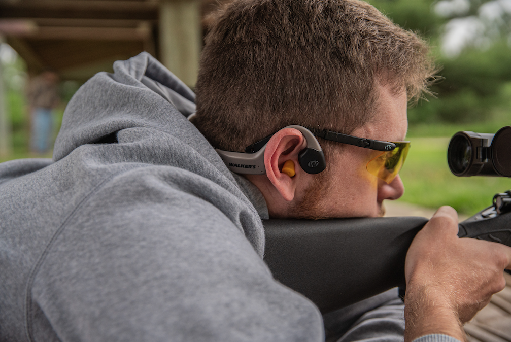 The Raptor sits outside the ear, as an enhancement, while in-ear plugs block damaging high-decibel sounds.
