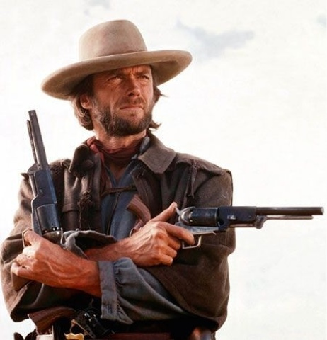 Eastwood/Wales' famous pose referenced by IMFDB, which prominently features his Colt revolvers.