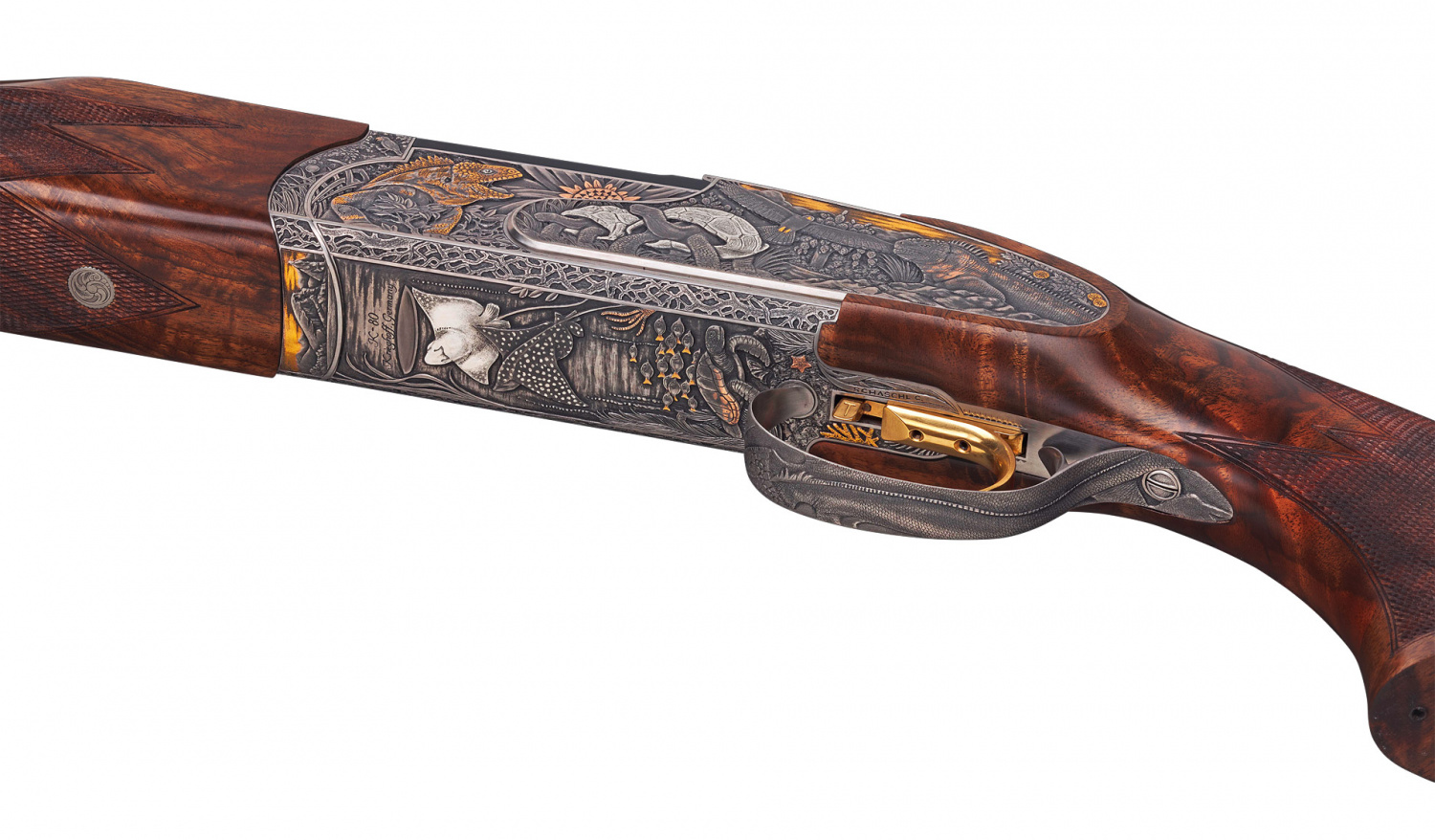 Even the trigger guard is engraved with a Galapagos Iguana's prickly back.