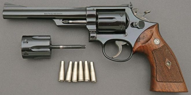 The S&W 53, complete with interchangeable .22lr cylinder. Image Source: Amoskeag Auction Company