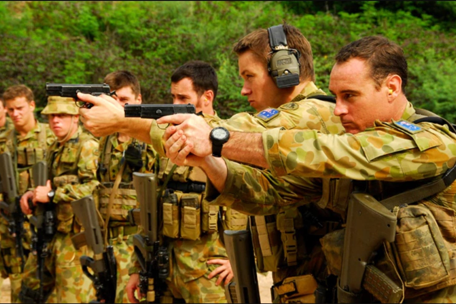Private Greg Harris and Private Peter Hallin fire their 9mm Browning pistols, during a range practice in Dili, East Timor, 2009. (Photo: Royal Australian Army)
